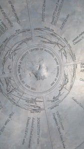 The compass-like marker at the top of the Tor