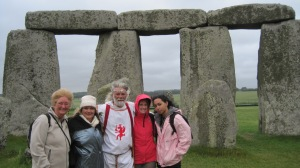 "Maureen, ""King Arthur,"" me, and Tres inside Stonehenge."